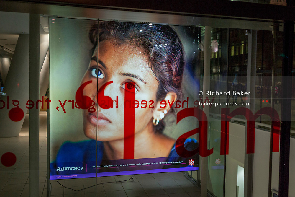 A lady's face helps raise awareness for a campaign about gender equality and violence against women and girls in Pakistan, featured in the window of the Salvation Army on Queen Victoria Street, in the Square Mile, the heart of the capital's historical financial district, on 2nd October 2017, in the City of London, England.