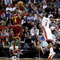 24 January 2012: Cleveland Cavaliers power forward Antawn Jamison (4) takes a jumpshot over Miami Heat power forward Chris Bosh (1) during the Miami Heat 92-85 victory over the Cleveland Cavaliers at the AmericanAirlines Arena, Miami, Florida, USA.