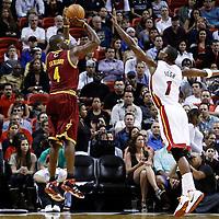 24 January 2012: Cleveland Cavaliers power forward Antawn Jamison (4) takes a jumpshot over Miami Heat power forward Chris Bosh (1) during the Miami Heat 92-85 victory over the Cleveland Cavaliers at the AmericanAirlines Arena, Miami, Florida, USA.