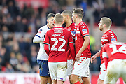 Tottenham Hotspur midfielder Erik Lamela (11) and Middlesbrough midfielder George Saville (22) have an exchange of views during the The FA Cup match between Middlesbrough and Tottenham Hotspur at the Riverside Stadium, Middlesbrough, England on 5 January 2020.