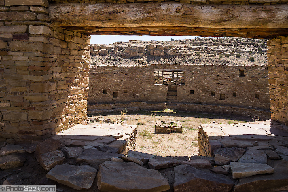 Casa Rinconada, occupied about AD 1140-1200, is an isolated great kiva (out of four in Chaco Canyon), built 63 feet (19 m) in diameter with a circular inner bench, masonry firebox, masonry vaults, 34 niches, four large pits for seating roof supports, plus an unusual 39-foot (12 m) passage dug underground through sandstone and shale. Chaco Culture National Historical Park hosts the densest and most exceptional concentration of pueblos in the American Southwest and is a UNESCO World Heritage Site. Chaco Canyon is in remote northwestern New Mexico, between Albuquerque and Farmington, USA. From 850 AD to 1250 AD, Chaco Canyon advanced then declined as a major center of culture for the Ancient Pueblo Peoples. Chacoans quarried sandstone blocks and hauled timber from great distances, assembling fifteen major complexes that remained the largest buildings in North America until the 1800s. Climate change may have led to its abandonment, beginning with a 50-year drought starting in 1130.