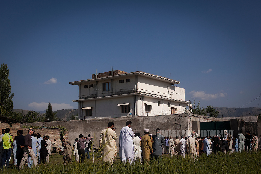 Locals and media gather outside the compound where Osama Bin Laden was reportedly killed in an operation by US Navy Seals, on May 3, 2011, in Abottabad, Pakistan. The operation, code-named Operation Neptune Spear, was launched from neighbouring Afghanistan by Seal Team Six. U.S. forces took bin Laden's body to Afghanistan for identification, then dumped it the Arabian Sea. Pakistan has since been widely suspected as having prior knowledge of his whereabouts as the compound was less than a kilometre from the country's biggest military academy. Osama bin Laden was allegedly responsible for supporting the bombing of the US Embassy in Nairobi, Kenya, the attack on the USS Cole and the suicidal attacks of September 11, 2001 in the US. (Photo by Warrick Page)