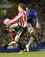 Photo: Aidan Ellis.<br /> Everton v Sunderland. The Barclays Premiership. 01/04/2006.<br /> Everton's Tim Cahill clashes with Sunderland's Dean Whitehead