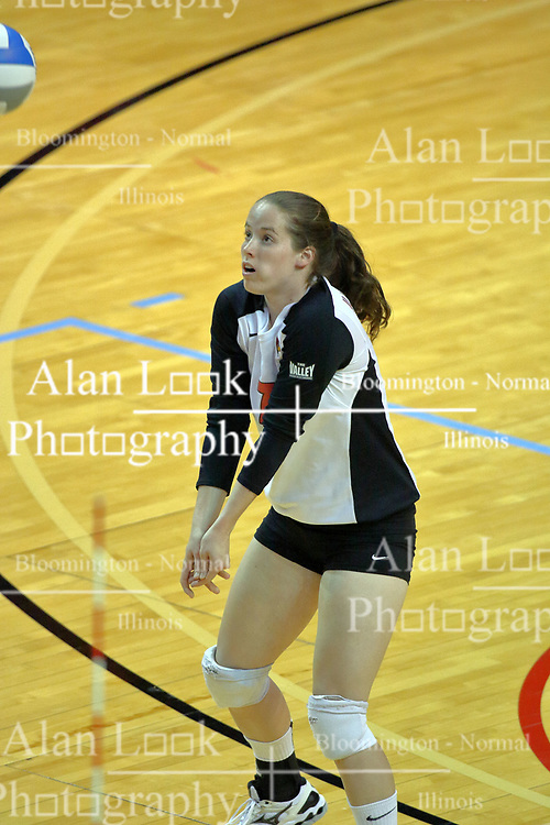 13 September 2011: Laura Wakefield sets the ball during an NCAA volleyball match between the Ramblers of Loyola and the Illinois State Redbirds at Redbird Arena in Normal Illinois.
