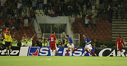 BELGRADE, SERBIA & MONTENEGRO - Wednesday, August 20, 2003: Wales' Ryan Giggs looks dejected as Serbia & Montenegro's Dragan Mladenovic celebrates scoring the only goal of the game during the UEFA European Championship qualifying match at the Red Star Stadium. (Pic by David Rawcliffe/Propaganda)