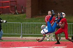 12 November 2005: A pass intended for Redbird Laurent Robinson is incomplete and upends a Sycamore. Illinois State Redbirds topple the Indiana State Sycamore 70-28 at Hancock Stadium in Normal Illinois