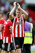John Lundstram of Sheffield United celebrates winning after the Premier League match between Sheffield United and Crystal Palace at Bramall Lane, Sheffield, England on 18 August 2019.