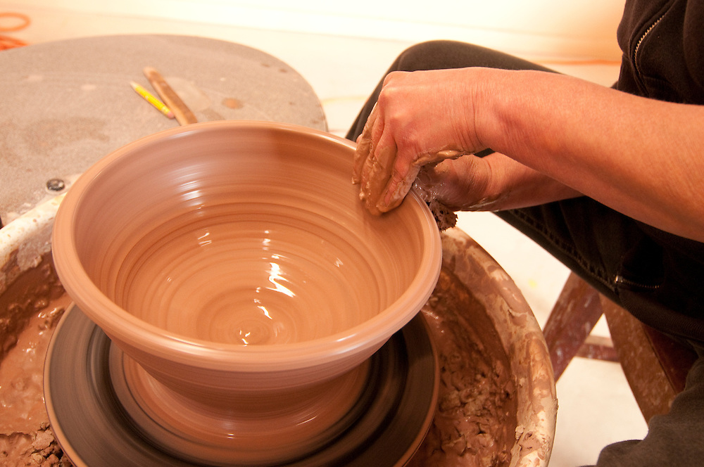 Artist Marsha LaTulip at work in her studio at LaTulip Pottery and Tile Works in Garden Michigan.