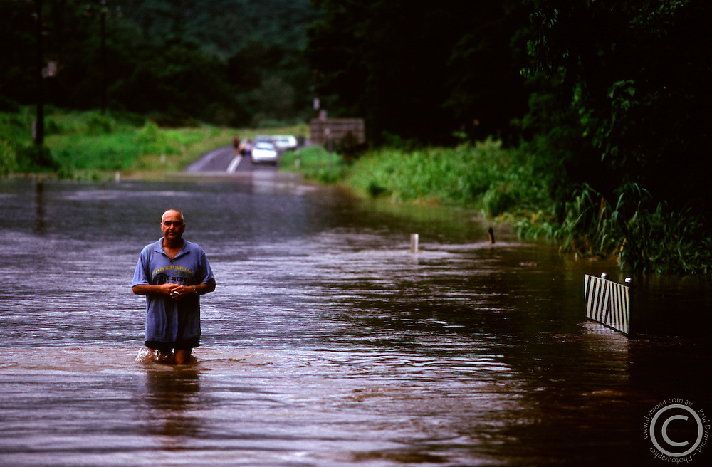 Annual flooding in far north Queensland leaves the locals quite blase about the effects. Here a man stands in deep waters at the entrance to Goldsborough Valley just south of Cairns.