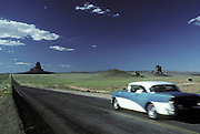 Historic Chevrolet on U.S. Hwy 163, Agathla Peak in distance, No. of Kayenta, Arizona, ©1988 Edward McCain, All Rights Reserved, McCain Photography 520-623-1998