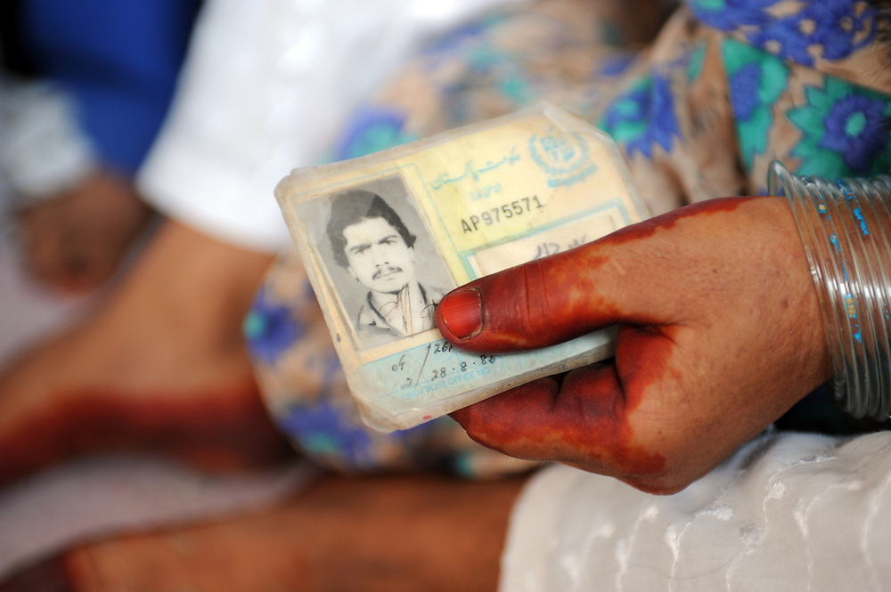 7/8/2009 A woman hold an identity card wiith a photograph of her husband on it in a rehabilitation centre in Jalalla which is supported by Trocaire through the Noor partnership. Jalalla, Pakistan.