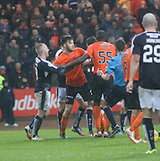 Dundee United&rsquo;s Scott&nbsp;Fraser (second left) holds back Dundee United&rsquo;s Guy Demel in the incident which led to the first of Demel's two bookings - Dundee v Dundee United, Ladbrokes Premiership at Dens Park<br /> <br />  - &copy; David Young - www.davidyoungphoto.co.uk - email: davidyoungphoto@gmail.com