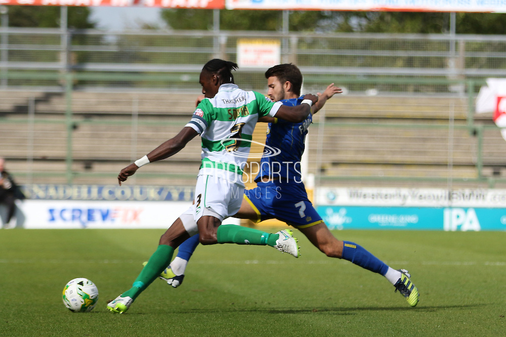 George Francomb of AFC Wimbledon and Nathan Smith battle during the Sky Bet League 2 match between Yeovil Town and AFC Wimbledon at Huish Park, Yeovil, England on 12 September 2015. Photo by Stuart Butcher.