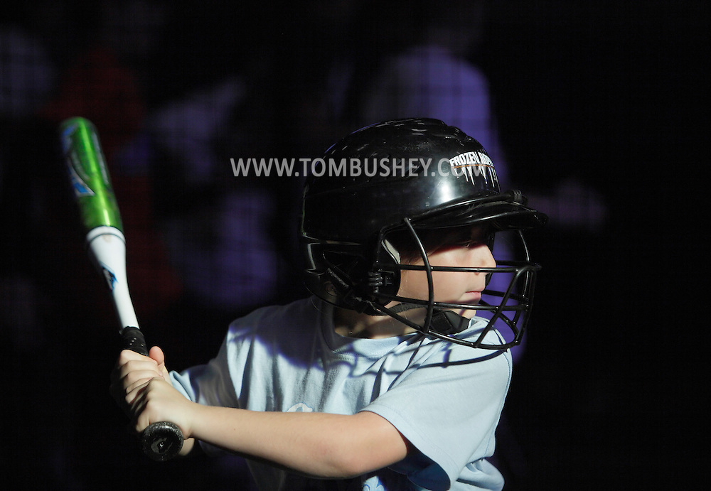 Chester, New York- A girl gets ready to take a swing in a batting cage during the first anniversary open house celebration at The Rock Sports Park on Nov. 12, 2011.