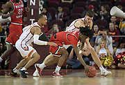 Western Kentucky Hilltoppers guard Taveion Hollingsworth (13) battles for the ball with Southern California Trojans guard Jordan McLaughlin (11) and forward Nick Rakocevic (31) during an NCAA college basketball game in the second round of the NIT tournament in Los Angeles, Monday, Mar 19, 2018. WKU defeated USC 79-75.