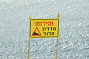 Israel, Hermon Mountain steep slope sign in Hebrew