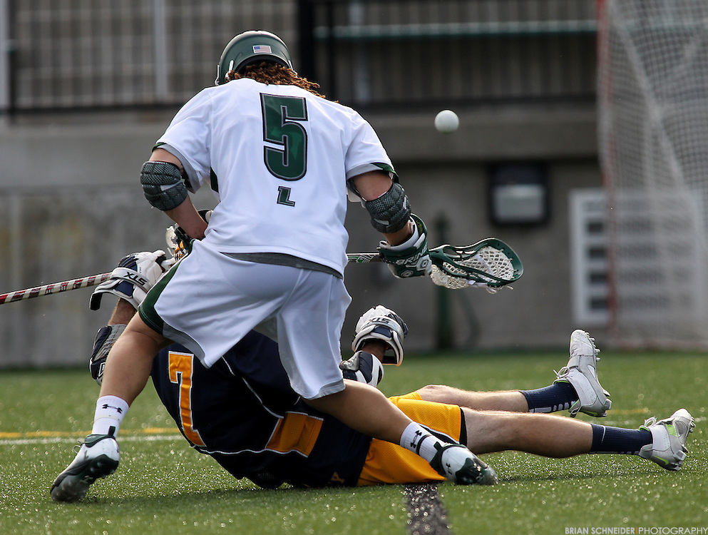May 12, 2012; Baltimore, MD, USA; Canisius College Golden Griffins Brendan O'Hagan (7) and Loyola Maryland Greyhounds Josh Hawkins (5) go for a loose ball at Ridley Athletic Complex in Baltimore, MD. Mandatory Credit: Brian Schneider-www.ebrianschneider.com