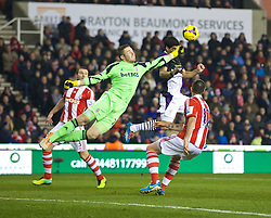 STOKE-ON-TRENT, ENGLAND - Sunday, January 12, 2014: Stoke City's goalkeeper Jack Butland in action against Liverpool's Luis Suarez during the Premiership match at the Britannia Stadium. (Pic by David Rawcliffe/Propaganda)