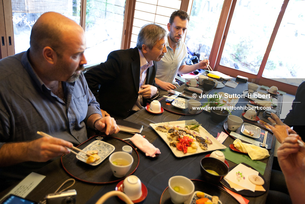 Hugh Montgomery (3rd from left)) of The Independent, and Tetsuro Hama (2nd from left of image)- owner of SO Restaurant London, dining in Kanga-an temple, a restaurant serving Shojin-ryori cuisine (eaten mainly by Buddhist followers), in Kyoto, Japan, on Friday 13th January 2012.