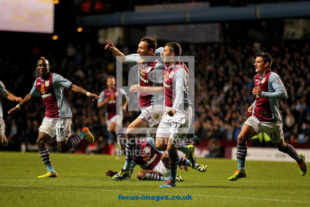 Picture by Tom Smith/Focus Images Ltd 07545141164<br /> 09/11/2013<br /> Libor Koz&aacute;k (centre) of Aston Villa celebrates scoring rot make it 2-0 with his team mates during the Barclays Premier League match at Villa Park, Birmingham.