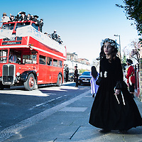 London, UK - 16 March 2014: a girl dressed in a fancy cloth from the Orthodox Jewish community of Stamford Hill celebrate the festivity of Purim, dancing and singing in the streets at the sound of Yiddish music and visiting wealthy businessmen collecting for their charity