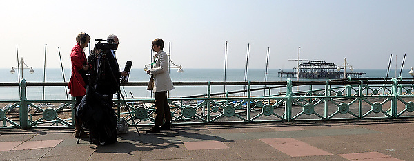 Caroline Lucas conduct press interviews on Brighton seafront after launching the Green Party manifesto in The Osbourne Room at the Hilton Metropole Hotel, Brighton this morning. She sat with Darren Johnson, the parliamentary candidate for Lewisham and a member of the London Assembly and Adrian Ramsay, Deputy Leader for the party and parliamentary candidate for Norwich South.