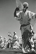 Asano Kiichi<br /> 1914 - 1993<br /> Awa-odori festival dance, 1950s.<br /> <br /> Vintage gelatin silver print that has on the reverse Asano's blue studio and red hanko stamps, as well as a caption inscription in the artist's hand.<br /> <br /> Size 6 1/2 in. x 4 3/4 in. (165 mm x 120 mm). <br /> <br /> Condition very good.<br /> <br /> Price ¥100,000<br /> <br /> <br /> <br /> <br /> <br /> <br /> <br /> <br /> <br /> <br /> <br /> <br /> <br /> <br /> <br /> <br /> <br /> <br /> <br /> .