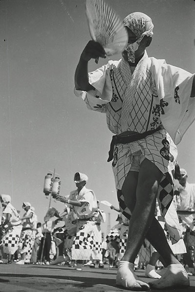 Asano Kiichi<br /> 1914 - 1993<br /> Awa-odori festival dance, 1950s.<br /> <br /> Vintage gelatin silver print that has on the reverse Asano&rsquo;s blue studio and red hanko stamps, as well as a caption inscription in the artist&rsquo;s hand.<br /> <br /> Size 6 1/2 in. x 4 3/4 in. (165 mm x 120 mm). <br /> <br /> Condition very good.<br /> <br /> Price &yen;80,000<br /> <br /> <br /> <br /> <br /> <br /> <br /> <br /> <br /> <br /> <br /> <br /> <br /> <br /> <br /> <br /> <br /> <br /> <br /> <br /> .