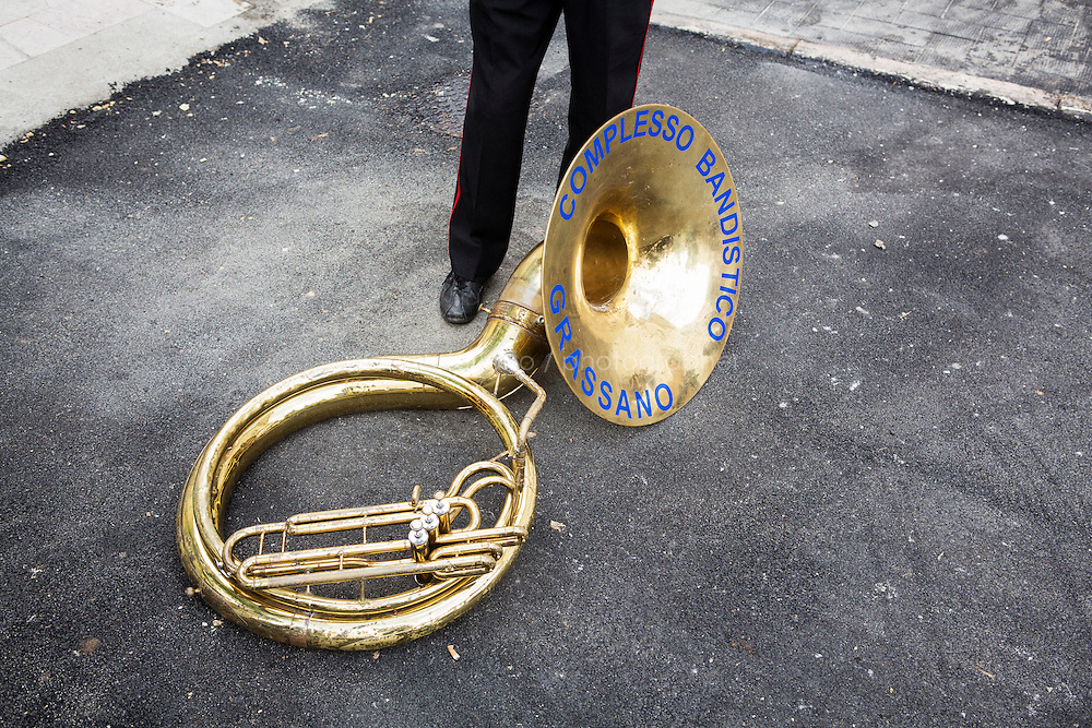 GRASSANO, ITALY - 24 JULY 2014: A sousaphone of a member of the Grassano marching band lays on the ground by the stage where the Mayor of New York Bill de Blasio is giving a speech in Grassano, his ancestral home town in Italy, on July 24th 2014.<br /> <br /> New York City Mayor Bill de Blasio arrived in Italy with his family Sunday morning for an 8-day summer vacation that includes meetings with government officials and sightseeing in his ancestral homeland.