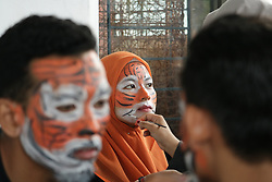 July 30, 2017 - Banda Aceh, Aceh, Indonesia - Dozens of people from various elements took action to commemorate World Tiger Day 2017. The action was colored with theatrical, some participants also painted his face like a tiger. Indonesia once had three types of tigers, Javan tigers and Bali tigers, already declared extinct. While the Sumatran tiger population continues to decrease because many are hunted. (Credit Image: © Abdul Hadi Firsawan/Pacific Press via ZUMA Wire)