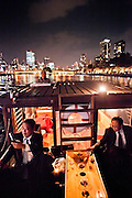 Salary men enjoy a boat cruise on the Osaka canals.