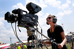 27 April 2013. New Orleans, Louisiana,  USA. .New Orleans Jazz and Heritage Festival. A TV camera woman captures events on the Congo Square stage..Photo; Charlie Varley.
