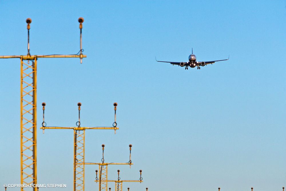 A plane approaching landing lights at Edinburgh airport