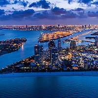 Aerial view of South Beach, South Pointe Park, Government Cut, Miami Beach and downtown Miami at twilight