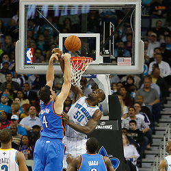 January 24,  2011; New Orleans, LA, USA; New Orleans Hornets center Emeka Okafor (50) blocks a dunk attempt by Oklahoma City Thunder power forward Nick Collison (4) during the second quarter at the New Orleans Arena. Mandatory Credit: Derick E. Hingle