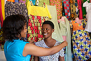 "Rahab Mbuba (left) measuring a customer for a new outfit.<br /> <br /> Rahab, also known as 'Mama B"", set up and now runs a tailoring business, designing and making clothes.<br /> <br /> She attended MKUBWA enterprise training run by the Tanzania Gatsby Trust in partnership with The Cherie Blair Foundation for Women."