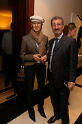 Mr. and Mrs. Eddie Jordan. Candy & Candy. Apartment launch party Fifth Floor, 17-22 Trevor Square Tim Jefferies<br />hosts reception previewing property designers latest apartment in Knightsbridge. 18 January 2005 ONE TIME USE ONLY - DO NOT ARCHIVE  © Copyright Photograph by Dafydd Jones 66 Stockwell Park Rd. London SW9 0DA Tel 020 7733 0108 www.dafjones.com