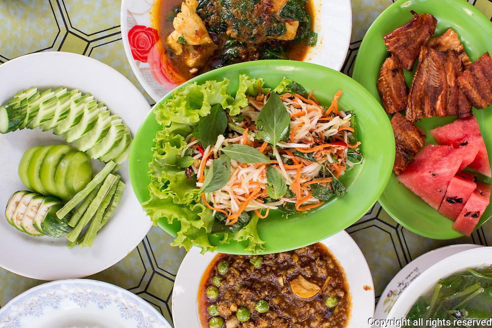 (same dishes as previous) Green mango and smoked fish salad (top/center) Chanreash 10 Makara Restaurant