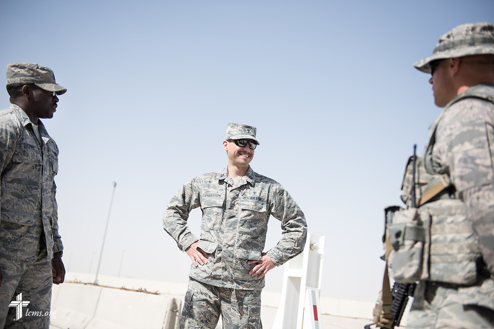Air Force Capt. Joseph Eggleston, chaplain, 386th Air Expeditionary Wing, greets security personnel on Monday, March 23, 2015. LCMS Communications/Erik M. Lunsford