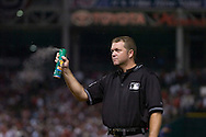 "Major League Baseball umpire Ron Kulpa sprays bug spray into the air during Game 2 of the 2007 ALDS at Jacobs Field in Cleveland. In what has become known at the ""Bug Game,"" midges infested the infield during the game but seemed to bother the visiting Yankees more than Cleveland."