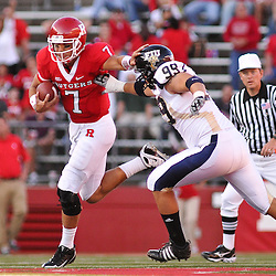 Sep 19, 2009; Piscataway, NJ, USA; Rutgers quarterback Tom Savage (7) stiff arms Florida International defensive end Thatcher Starling (99) while scrambling during the first half of NCAA college football between Rutgers and Florida International at Rutgers Stadium.