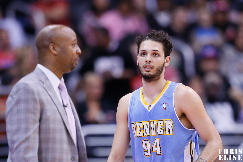 15 April 2014: Denver Nuggets guard Evan Fournier (94) listens to Denver Nuggets head coach Brian Shaw during the Los Angeles Clippers 117-105 victory over the Denver Nuggets at the Staples Center, Los Angeles, California, USA.
