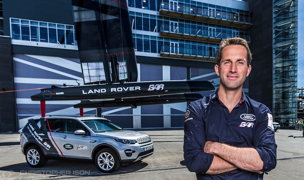 Sir Ben Ainslie poses with his AC45 foiling catamaran at the newly opened BAR (Ben Ainslie Racing) HQ in Portsmouth, Hampshire. The world's most successful Olympic sailor and his team will compete to win the oldest sporting trophy, The America's Cup, in Bermuda in 2017. The first stage of the contest will be held close to the base in Portsmouth next month when competing nations converge on the city for the inaugural America's Cup World Series regatta. <br /> Picture date Wednesday 24th June, 2015.<br /> Picture by Christopher Ison. Contact +447544 044177 chris@christopherison.com