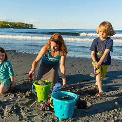 A woman and her young son and daughter play at Seapoint Beach in Kittery, Maine.
