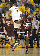 Feb 19, 2011; Long Beach, CA, USA; Long Beach State 49ers guard Larry Anderson (21) is defended by Montana Grizzlies guard Will Cherry (5) at the Walter Pyramid. Long Beach State defeated Montana, 74-56.