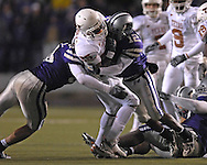Kansas State defensive back Devin Anderson (12) hits Texas running back Jamaal Charles (25) after a short gain in the second half at Bill Snyder Family Stadium in Manhattan, Kansas, November 11, 2006.  The Wildcats upset the 4th ranked Longhorns 45-42.<br />
