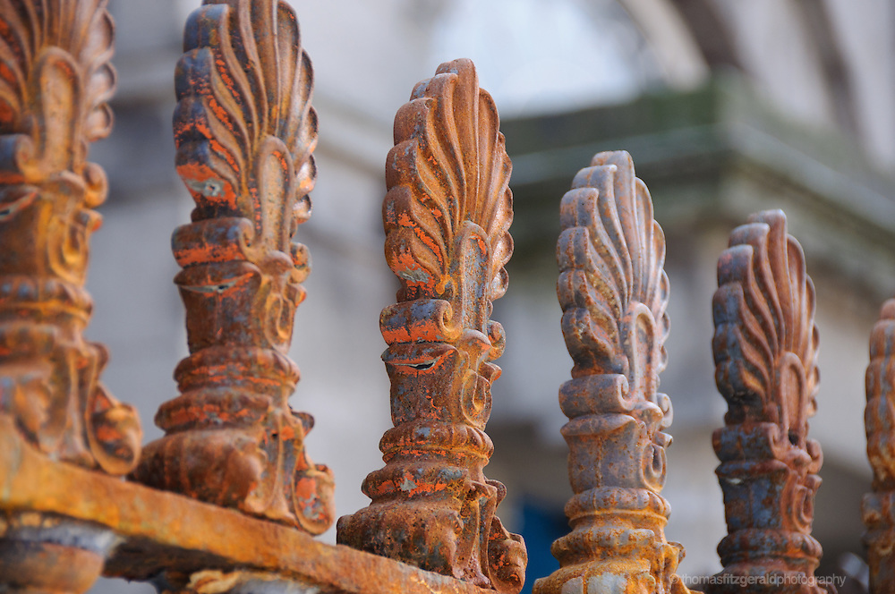 Close up of the dramatic pattern and colours of a series of rusty railings