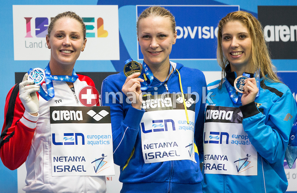 (L-R) Second placed Jeanette OTTESEN of Denmark, winner Sarah SJOSTROM (SJOESTROEM) of Sweden and third placed Alexandra WENK of Germany pose with their medals after competing in the women's 100m Butterfly Final during the 18th LEN European Short Course Swimming Championships held at the Wingate Institute in Netanya, Israel, Sunday, Dec. 6, 2015. (Photo by Patrick B. Kraemer / MAGICPBK)
