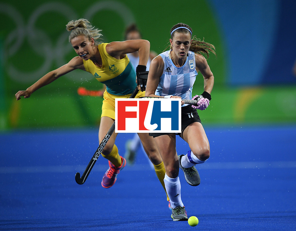 Argentina's Carla Rebecchi (R) and Australia's Gabi Nance  vie for the ball during the women's field hockey Australia vs Argentina match of the Rio 2016 Olympics Games at the Olympic Hockey Centre in Rio de Janeiro on August, 11 2016. / AFP / MANAN VATSYAYANA        (Photo credit should read MANAN VATSYAYANA/AFP/Getty Images)