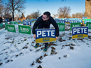 14 JANUARY 2020 - DES MOINES, IOWA: ISAAC DAYNO, with the Buttigieg campaign sets out Buttiegieg signs before the CNN Democratic Presidential Debate on the campus of Drake University in Des Moines. This is the last debate before the Iowa Caucuses on Feb. 3.    PHOTO BY JACK KURTZ